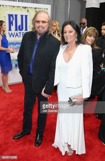 Recording artist Barry Gibb and Linda Gray at The 59th Annual GRAMMY Awards at STAPLES Center on February 12, 2017 in Los Angeles, California.