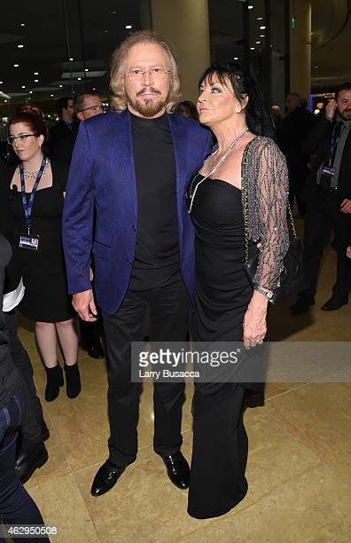 Recording artist Barry Gibb and Linda Gray attend the PreGRAMMY Gala and Salute To Industry Icons honoring Martin Bandier on February 7 2015 in Los...