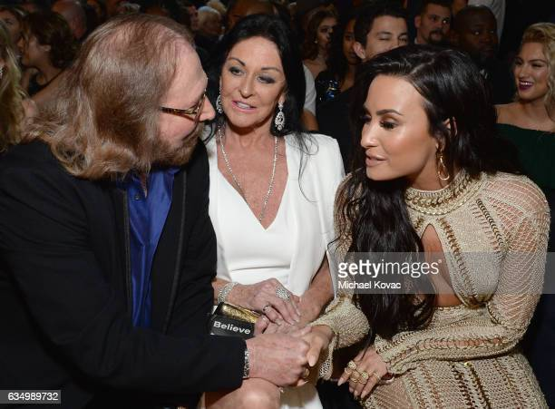Recording artist Barry Gibb Linda Gray and recording artist Demi Lovato attend The 59th GRAMMY Awards at STAPLES Center on February 12 2017 in Los...
