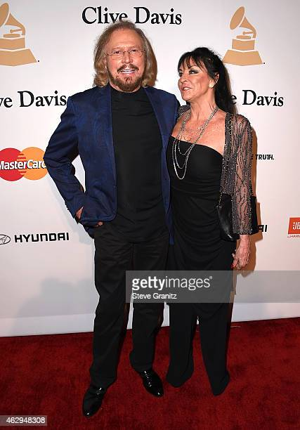 Recording artist Barry Gibb of The Bee Gees and Linda Gray attend the Pre-GRAMMY Gala and Salute To Industry Icons honoring Martin Bandier on...