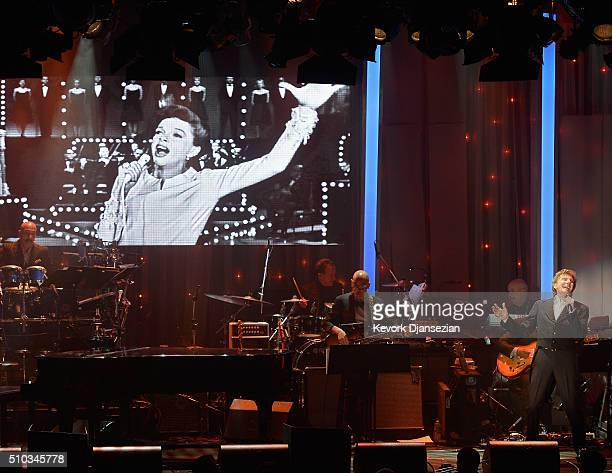 Recording artist Barry Manilow performs a virtual duet with the late Judy Garland onstage during the 2016 PreGRAMMY Gala and Salute to Industry Icons...