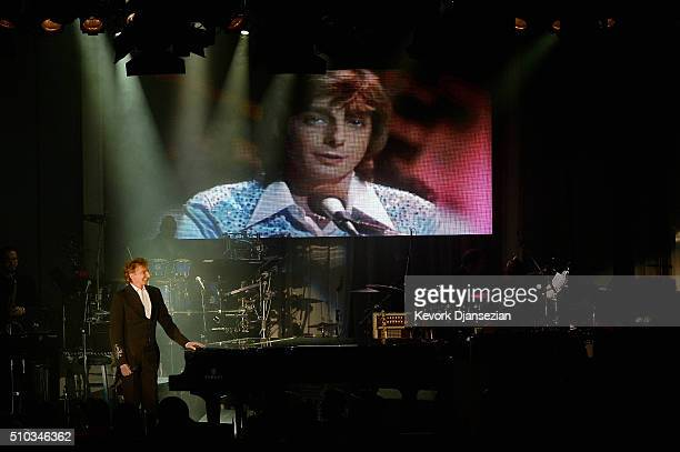 Recording artist Barry Manilow stands onstage as a video tribute commemorating the 40th anniversary of his song 'Mandy' is played during the 2016...