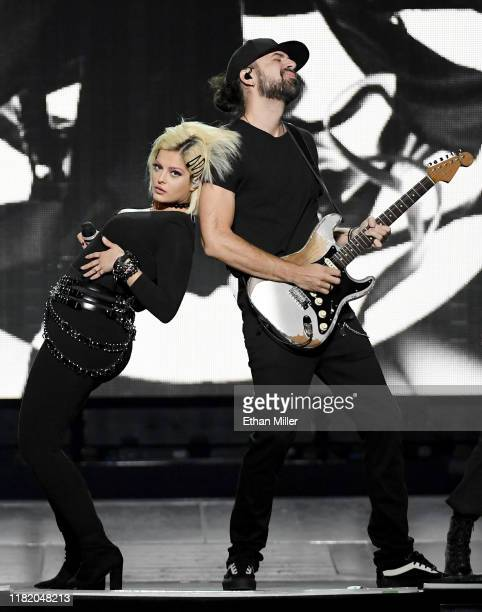 Recording artist Bebe Rexha performs with guitarist Everett Gray as they open for Jonas Brothers during a stop of the group's Happiness Begins Tour...