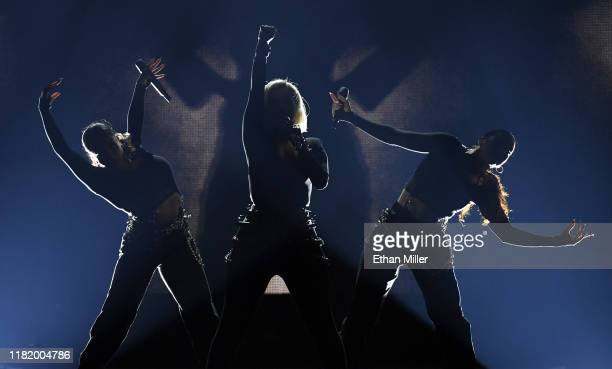 Recording artist Bebe Rexha performs with singer/dancers Ari Rosado and Randi Liberman as they open for Jonas Brothers during a stop of the group's...