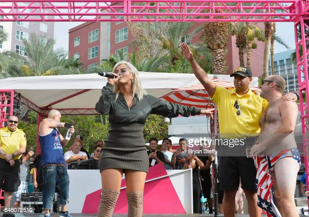 Recording artist Bebe Rexha reacts as a fan that she invited onstage dances during her performance at the Flamingo GO pool at Flamingo Las Vegas on...