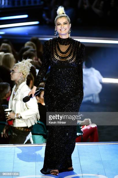 Recording artist Bebe Rexha speaks onstage during the 2018 Billboard Music Awards at MGM Grand Garden Arena on May 20 2018 in Las Vegas Nevada
