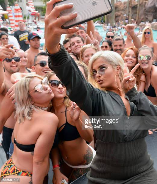 Recording artist Bebe Rexha takes a selfie with a fan after performing at the Flamingo GO pool at Flamingo Las Vegas on September 9 2017 in Las Vegas...