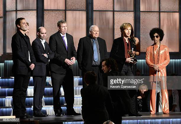 """Recording artist Beck and members of his production team accept the Album of the Year award for """"Morning Phase"""" from singer Prince onstage during The..."""