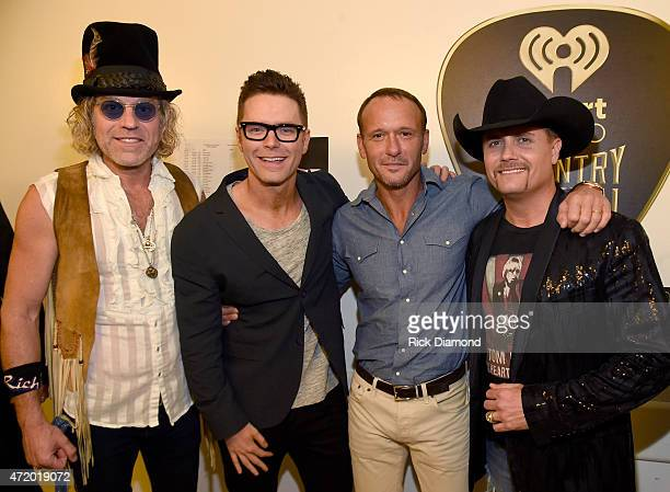 Recording artist Big Kenny of Big Rich radio personality Bobby Bones recording artists Tim McGraw and John Rich of Big Rich pose backstage during the...