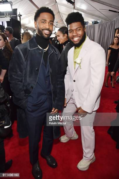 Recording artist Big Sean and Khalid white rose detail attend the 60th Annual GRAMMY Awards at Madison Square Garden on January 28 2018 in New York...