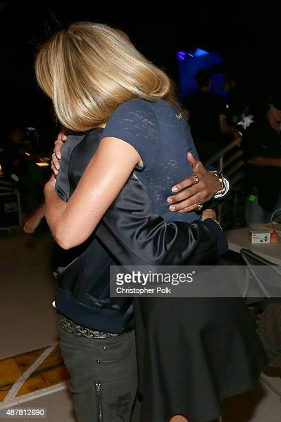 Recording artist Big Sean embraces actress Gwyneth Paltrow during the Think It Up education initiative telecast for teachers and students hosted by...