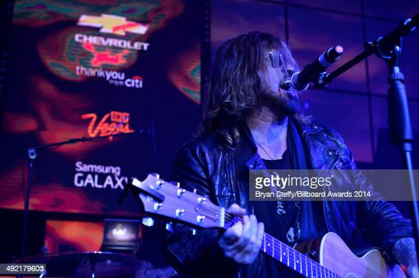 Recording artist Billy Ray Cyrus performs onstage during the Official AfterParty for the 2014 Billboard Music Awards at The Light at Mandalay Bay...