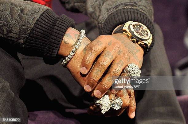 Recording artist Birdman bracelet ring tattoo manicure watch and fashion details speaks during the Genius Talks sponsored by ATT during the 2016 BET...