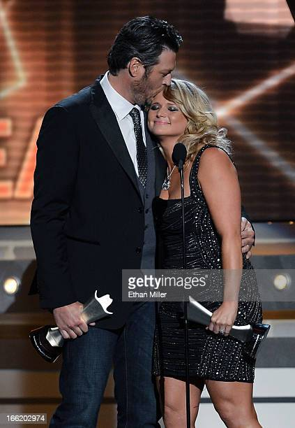 Recording artist Blake Shelton kisses his wife recording artist Miranda Lambert as they accept the award for Song of the Year for Over You during the...