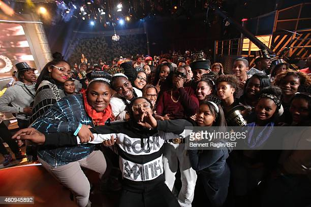 Recording artist Bobby Shmurda poses for a picture with the 106 Party audience during 106 Party at BET studio on December 12 2014 in New York City