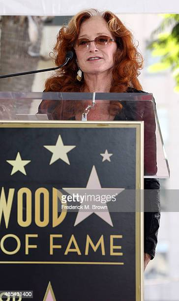 Recording artist Bonnie Raitt speaks during music executive Joe Smith's ceremony honoring him with a Star on the Hollywood Walk of Fame on August 27...