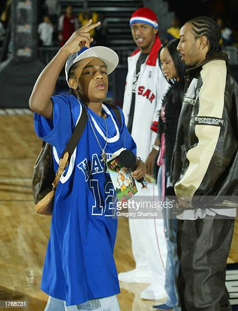 Recording artist Bow Wow is introduced at the Read to Achieve rally with Ludacrus Nivea and Nick Cannon in the background on February 7 2003 at the...