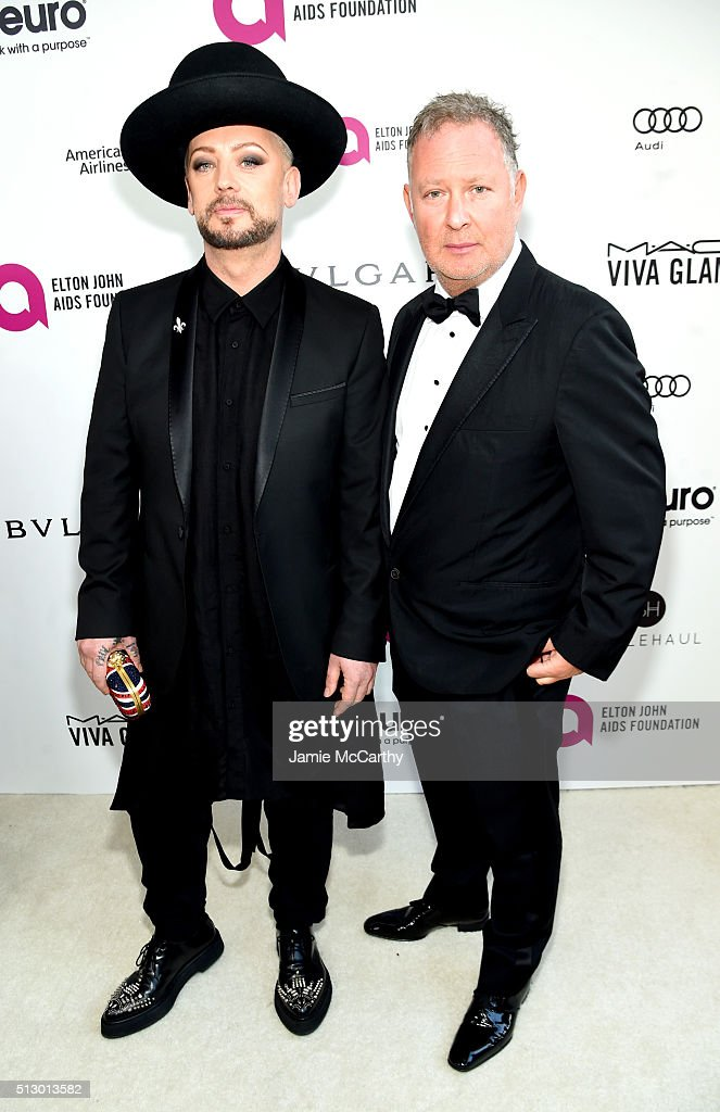 Recording artist Boy George (L) and guest attend the 24th Annual Elton John AIDS Foundation's Oscar Viewing Party at The City of West Hollywood Park on February 28, 2016 in West Hollywood, California.