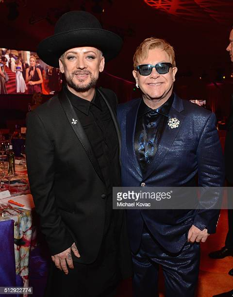 Recording artist Boy George and host Sir Elton John attend the 24th Annual Elton John AIDS Foundation's Oscar Viewing Party at The City of West...