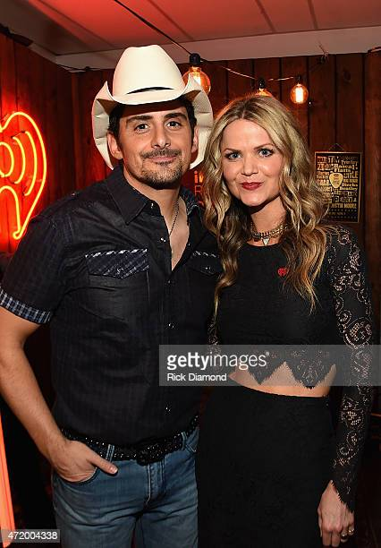 Recording artist Brad Paisley and radio personality Amy Moffett pose backstage during the 2015 iHeartRadio Country Festival at The Frank Erwin Center...