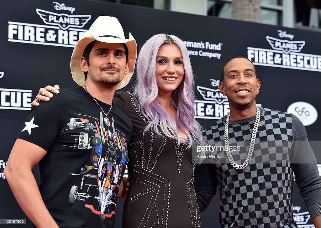 Recording artist Brad Paisley, Kesha and Chris 'Ludacris' Bridges attend the premiere of Disney's 'Planes: Fire & Rescue' at the El Capitan Theatre on July 15, 2014 in Hollywood, California.