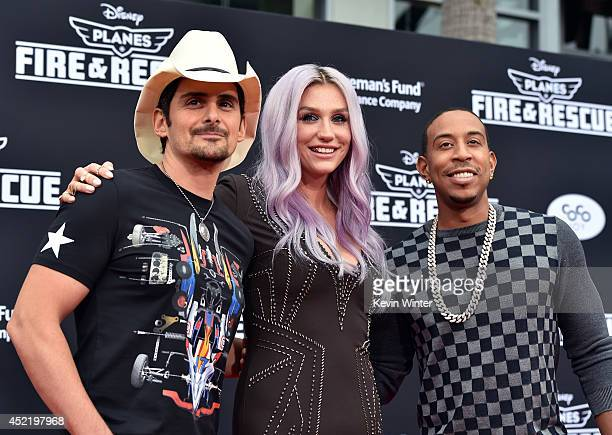 Recording artist Brad Paisley Kesha and Chris 'Ludacris' Bridges attend the premiere of Disney's 'Planes Fire Rescue' at the El Capitan Theatre on...