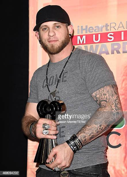 Recording artist Brantley Gilbert, winner of the Renegade Award, poses in the press room during the 2015 iHeartRadio Music Awards which broadcasted...