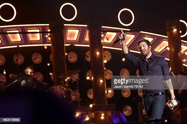 """Recording artist Brett Eldredge accepts the Song of the Year award for '""""Beat of the Music' onstage during the 2014 American Country Countdown Awards..."""