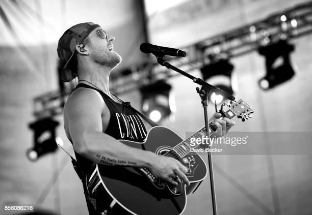 Recording artist Brett Young performs during the Route 91 Harvest country music festival at the Las Vegas Village on September 30 2017 in Las Vegas...