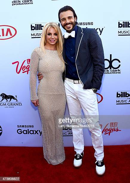 Recording artist Britney Spears and Charlie Ebersol attend the 2015 Billboard Music Awards at MGM Grand Garden Arena on May 17 2015 in Las Vegas...