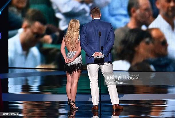 Recording artist Britney Spears and NFL player J J Watt speak onstage during The 2015 ESPYS at Microsoft Theater on July 15 2015 in Los Angeles...