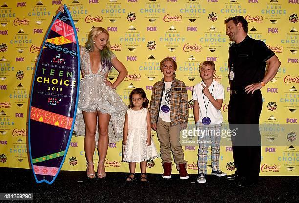 Recording artist Britney Spears poses with Maddie Briann Aldridge, Sean Preston Federline, and Jayden James Federline in the press room during the...
