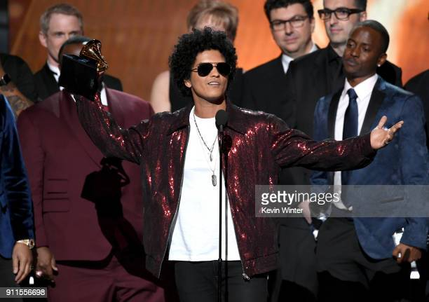 Recording artist Bruno Mars accepts Album of the Year for '24K Magic' with production team onstage during the 60th Annual GRAMMY Awards at Madison...