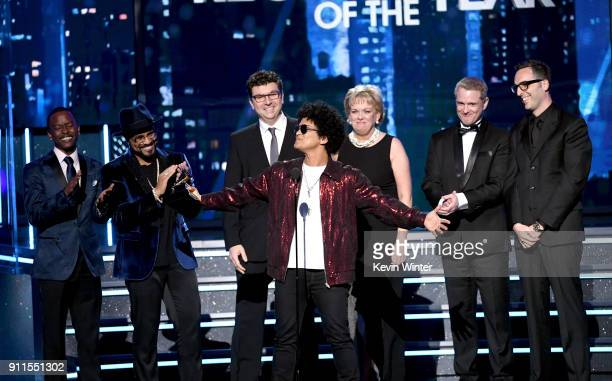 Recording artist Bruno Mars accepts Record of the Year for '24K Magic' with production team onstage during the 60th Annual GRAMMY Awards at Madison...
