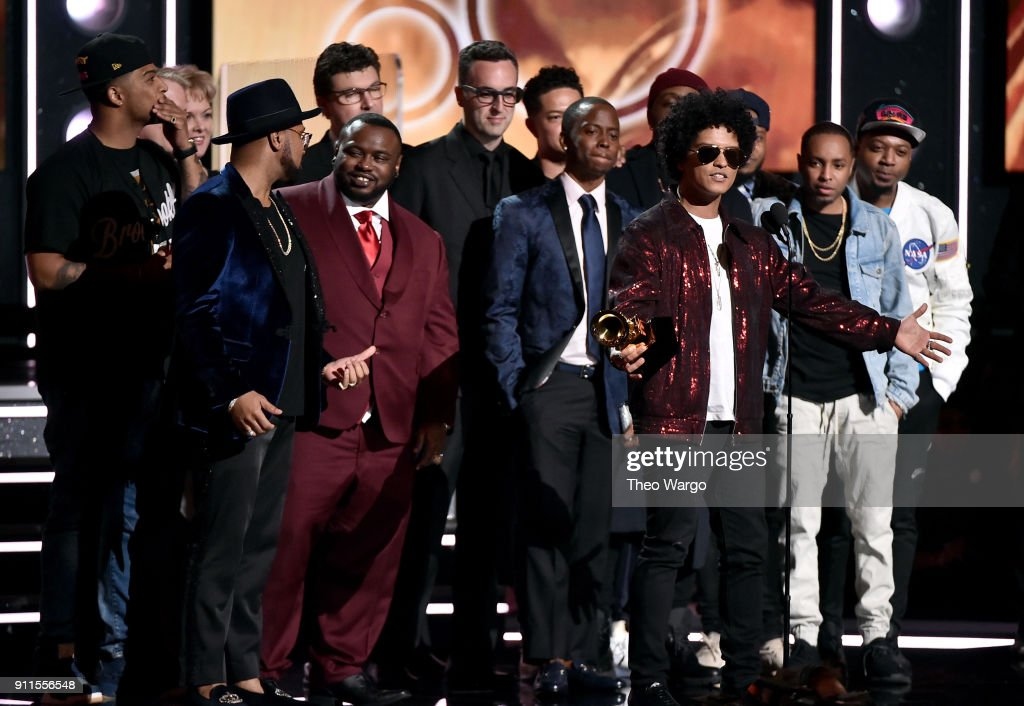 Recording artist Bruno Mars (holding GRAMMY award trophy) and production team accept the Album Of The Year award for '24K Magic' onstage during the 60th Annual GRAMMY Awards at Madison Square Garden on January 28, 2018 in New York City.