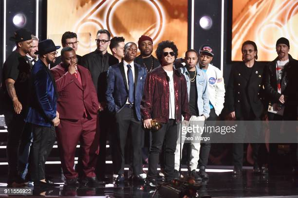 Recording artist Bruno Mars and production team accept the Album Of The Year award for '24K Magic' from recording artists Bono and The Edge of...