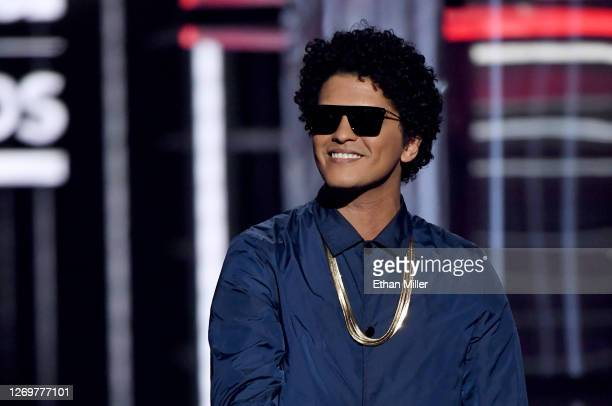 Recording artist Bruno Mars speaks during the 2018 Billboard Music Awards at MGM Grand Garden Arena on May 20, 2018 in Las Vegas, Nevada.