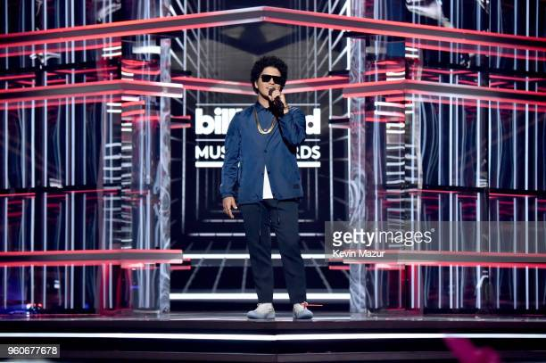 Recording artist Bruno Mars speaks onstage at the 2018 Billboard Music Awards at MGM Grand Garden Arena on May 20 2018 in Las Vegas Nevada