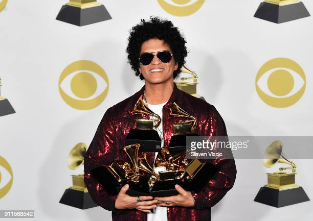 Recording artist Bruno Mars winner of Album of the Year for '24K Magic' poses in the press room during the 60th Annual GRAMMY Awards at Madison...