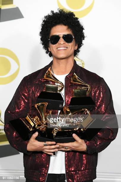 Recording artist Bruno Mars winner of, Album of The Year, Song of The Year, Best R and B Album, Best R and B Performance and Record of The Year poses...