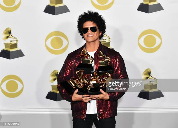 Recording artist Bruno Mars winner of Album of The Year Song of The Year Best R and B Album Best R and B Performance and Record of The Year poses in...