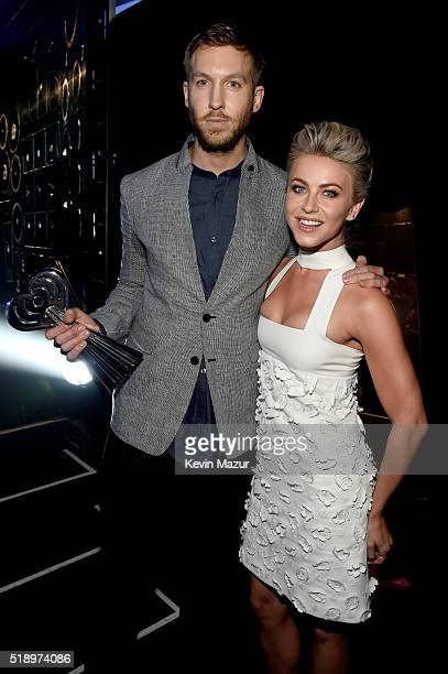 Recording artist Calvin Harris and dancer Julianne Hough backstage at the iHeartRadio Music Awards which broadcasted live on TBS TNT AND TRUTV from...
