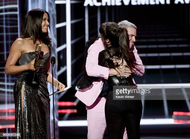 Recording artist Camila Cabello accepts the Billboard Chart Achievement Award from TV personalities Padma Lakshmi and Andy Cohen onstage during the...