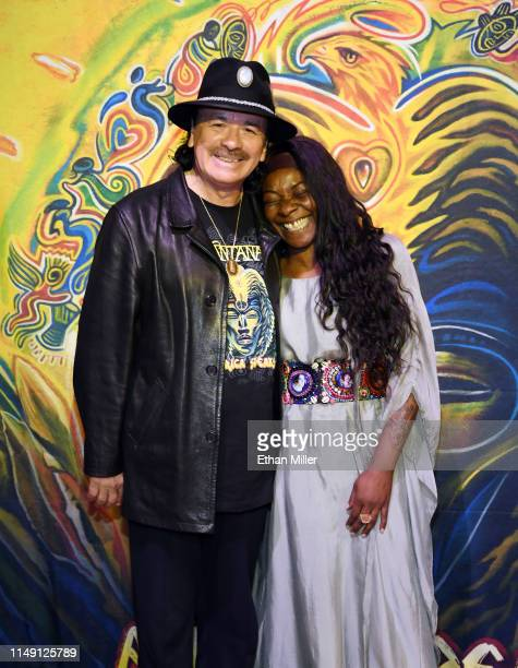 Recording artist Carlos Santana and singer Buika pose during a listening event for Santana's upcoming album Africa Speaks featuring Buika at the...