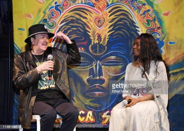 Recording artist Carlos Santana and singer Buika speak during a listening event for Santana's upcoming album Africa Speaks featuring Buika at the...