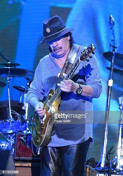 Recording artist Carlos Santana performs onstage at 2016 Many Rivers to Cross Festival at Bouckaert Farm on October 1 2016 in Fairburn Georgia