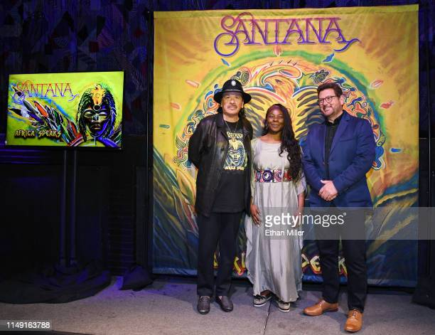 Recording artist Carlos Santana singer Buika and Concord Records President John Burk pose during a listening event for Santana's upcoming album...