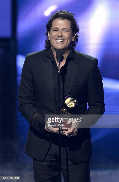 Recording artist Carlos Vives accepts the award for Best Tropical Fusion Album for 'Corazón Profundo' onstage during The 14th Annual Latin GRAMMY...