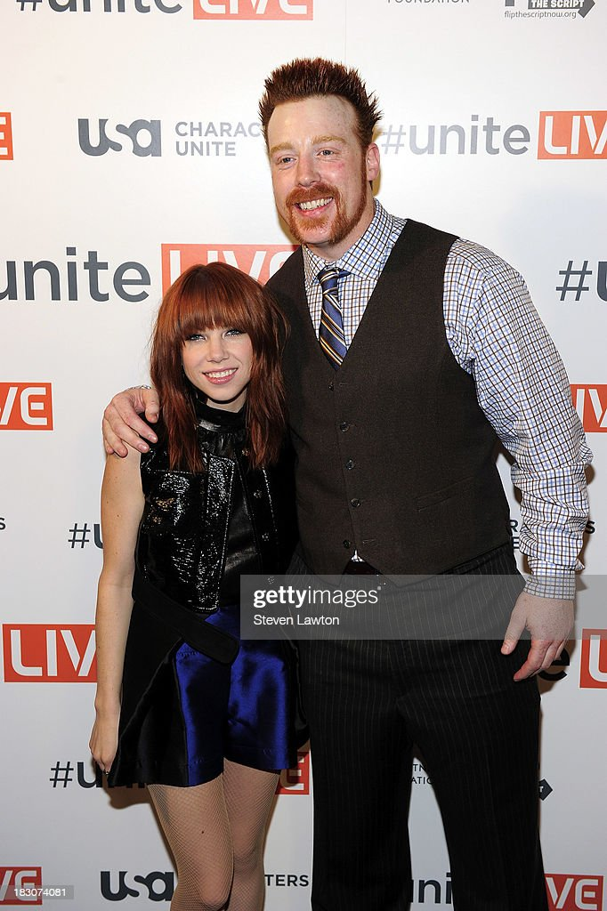 Recording artist Carly Rae Jepsen (L) and WWE Superstar Sheamus arrive at 'UniteLIVE: The Concert to Rock Out Bullying' at the Thomas & Mack Center on October 3, 2013 in Las Vegas, Nevada.