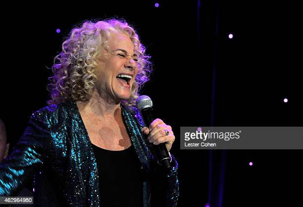 Recording artist Carole King performs onstage at the PreGRAMMY Gala and Salute To Industry Icons honoring Martin Bandier at The Beverly Hilton Hotel...